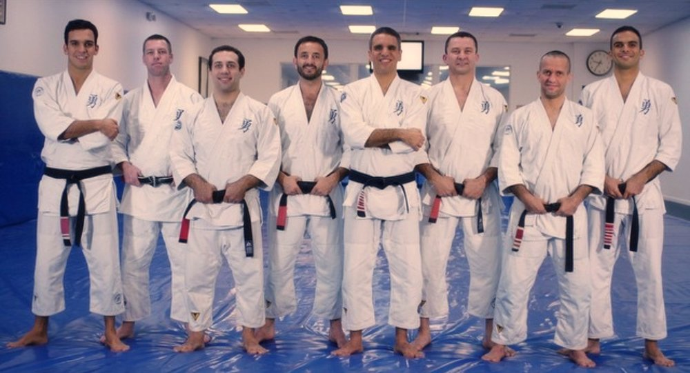 Pedro, Gui, Joaquim and Jimmy, in 2015, with the new VB Professors before the belt system change to the Navy Belt and Black Belt with blue bars.