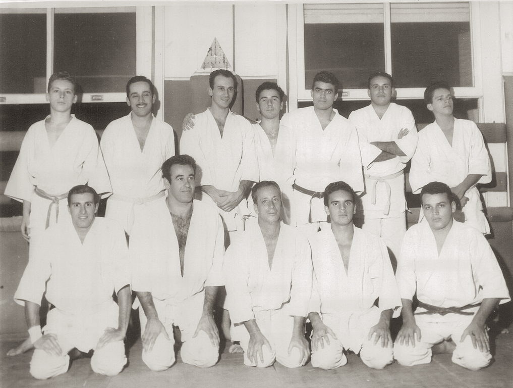 The original Academia Gracie de Jiu-jitsu where Grand Master Pedro Valente Sr. ( bottom row 2nd from right to left) trained in the 1950s. Until 1967, students did not receive any belt promotions. Instructors wore light blue belts and Professors earned the coveted Navy Belt.